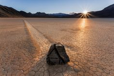 "Sunset on the Racetrack - The sun sets over the Racetrack in Death Valley National Park. This is one of the more interesting ""moving rocks"" on the playa."