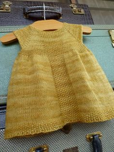 Knitting pattern for baby dress on RavelryRavelry: summer top made from scarf and crochet yoke - free pattern with charts.Ravelry: Rio Dress pattern by Taiga Hilliard so making this for the baby!I need to find someone who has a girl so I can crochet Knitting For Kids, Baby Knitting Patterns, Free Knitting, Beginner Knitting, Knitting Ideas, Knit Baby Dress, Knitted Baby Clothes, Baby Knits, How To Purl Knit
