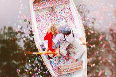 confetti on a canoe engagement photo
