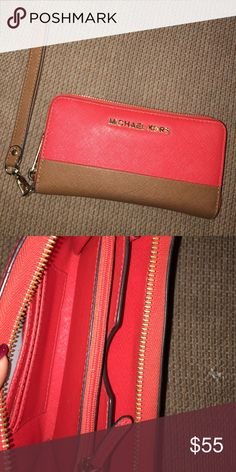 Michael Kors wallet Red and brown michael kors wallet lightly used great condition! Michael Kors Bags Wallets