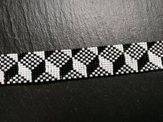 Hand-woven Miyuki rocaille pearl pixel bracelet in black and white. Made in... - #black #Bracelet #HandWoven #miyuki #Pearl #Pixel #rocaille #white