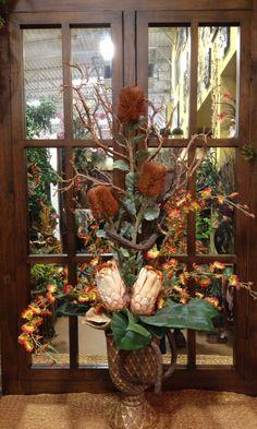 Protea orchid arrangement