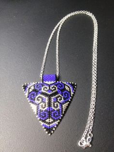 Silver plated triangle peyote necklace....(pattern from anabel27.com)
