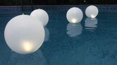 These floating solar pool lights allow you to select a color option and have a loop to anchor them so they don't bunch up. #floatingsolarpoollights