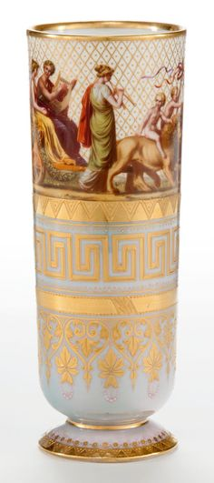 A ROYAL VIENNA STYLE PORCELAIN HAUSMALER DECORATED VASE  Maker unknown, Continental, circa 1870  Marks: (shield), 55, 2  7-1/8 inches high (18.1 cm)    The cylindrical footed vase with a frieze of classically draped  figures against a diapered background above decorative bands with  gilt classical motifs on a pale blue ground.  			  						  			  			  			  			Maker unknown:.   			  							Condition Report*:  				The vase with some loss to gilt decoration.