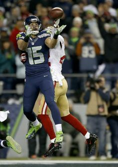 Wide receiver Jermaine Kearse #15 of the Seattle Seahawks catches a fourth quarter touchdown against the San Francisco 49ers during the 2014 NFC Championship at CenturyLink Field on January 19, 2014 in Seattle, Washington. (Photo by Otto Greule Jr/Getty Images)