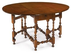 A Very Rare William and Mary Turned Maple Gateleg Table, Newport, Rhode Island, Circa 1715 -  Height 28 1/2 in. by Depth 47 3/4 in. by Width closed 18 3/4 in.