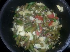Green bean casserole of green beans, artichokes, cactus , tomatoes apples pecan pieces in lemon butter sauce.