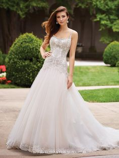 This metallic lace, tulle, and satin A-line gown with hand-beaded thin shoulder straps features a dropped waist and low scoop back finished with full skirt.