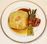 Dinner Party Menu | | Beef Wellington with Mushroom Duxelles in Madeira Sauce | Mixed Greens with Champagne Poached Pears | Bacon-Wrapped Asparagus | Roasted Tomatoes | Potato Puffs | Chocolate Mousse in Shells |  Creme Anglaise