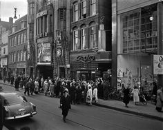 """1951. People are waiting in line at the Tuschinski Theater in the Reguliersbreestraat for a showing of the movie version of the opera """"Wesseling"""". Photo AHF, Collectie IISG / Ben van Meerendonk. #amsterdam #1951 #Reguliersbreestraat"""