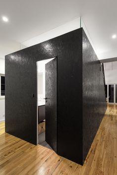 'Black Box' in Portugal Remodel Hides Some Surprises - http://freshome.com/black-box-portugal-remodel/