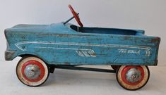 "A vintage (1950s) Murray ""Tee Bird"" steel pedal car. Neighbor children had a car like this I remember riding. The all-original one shown here is worn, but that makes sense: pedal cars were sturdy and well-loved, so they got passed down and played with by many children. Once you were too big to drive, smaller children welcomed their turn."