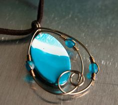 Marine Blue and Antiqued Brass Spiral Necklace by mlwdesigns, $20.00