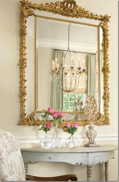 love the mix of gold elegant mirror with shabby chic table...perfection