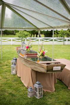 dressing up an old wooden boat as a bar - love this idea!