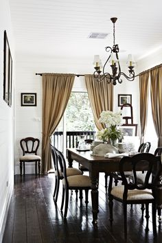 elegant neutral dining room with traditional/cottage mix