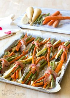 These enticing roasted vegetables are tied in a bacon bow and finished with cider maple glaze! Bacon wrapped carrots, asparagus and parsnips roasted to perfecti