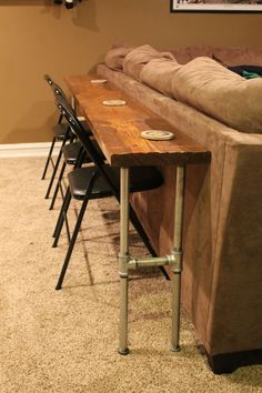 sofa table/bar table made from 2x8x12 board and conduit. great for the basement media room