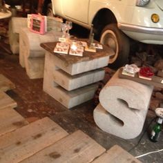 Concrete letters... they would make great coffee table stands, and probably look great with glass tops