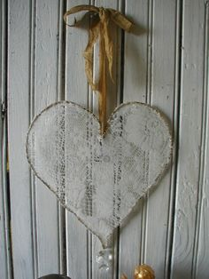 Handmade wire heart with ecru color vintage lace  salvaged curtain stretched and securely hand stitched along the heart wire heart. The
