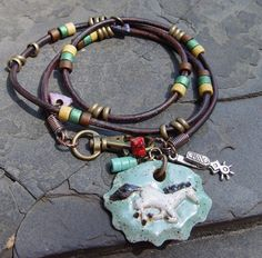 Silver Spurs - Horse Three Wrap Greek Ceramic and Greek Leather Brass Bracelet or Long Necklace. $59.50, via Etsy.