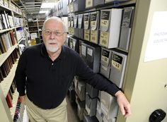"""Winona County Historical Society archivist Walter Bennick has written and selected photos for his book on Winona's history named """"Images of America: Winona."""" (Andrew Link/Winona Daily News)"""