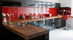 Kitchen Design Ideas Visual | Glossy red adds some glamour against the dark wood!