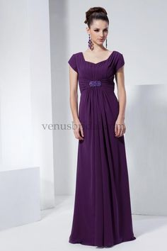 Modest chiffon gown with rouched bodice and petal sleeves. Beaded applique at empire waist. Zipper back