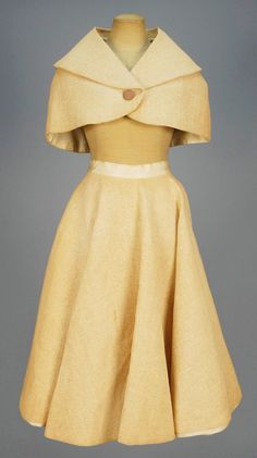 Novelty Capelet and Circle Skirt, 1957.  Woven beige paper with gold lurex threads, capelet with shawl collar and single button, circle skirt having satin waistband and lining.