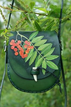 Double-carved rowan bag with flowers, leaves and berries