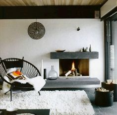Love the modern (but chunky, not too sleek) fireplace, the dark floors and the wood by the ceiling that keeps it from being too white.