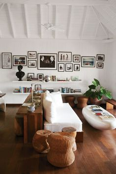 Photographs of James Bond author Ian Fleming with assorted dignitaries line the walls of the library at GoldenEye, his former Jamaican home.