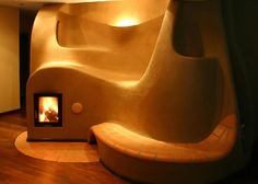 Smoothly sculpted cob fireplace, double bench and lighting detail