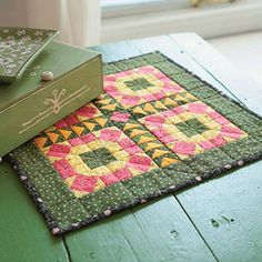 """Stitch up tiny quilts (less than 26"""" square) in a flash using these free patterns for small quilts. #tablerunners #quilting #wallhanging"""