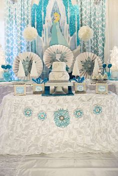 Gorgeous Frozen Birthday Party dessert table and backdrop! Disney frozen party ideas!