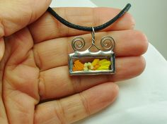 Interesting bale. Pressed Flower Necklace - Stained Glass Pendant - Real Flowers - Soldered Jewelry - silver. $12.00, via Etsy..