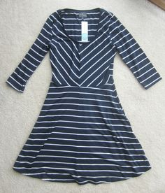 Cute dress!  I like this one but I think I like the other navy and striped dress I have pinned better.