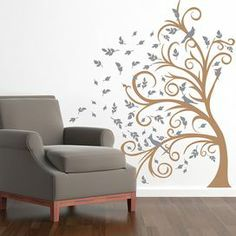 "Whether beside the doorway or adorning an accent wall, this curving tree decal fills your home with organic whimsy.   Product: Wall decalConstruction Material: VinylColor: Light brown and middle greyDimensions: 72"" H x 43"" W"