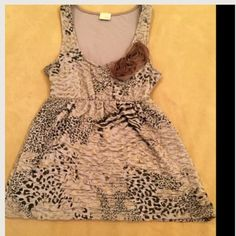 $$$$ DROP!! Fancy & Fabulous Top.. An elastic waste line not only gives this fancy top flair .. it also makes it very comfy!! Fully lined. Animal print. Beautiful pearl and lace appliqué on the front. Daytrip Tops Tank Tops