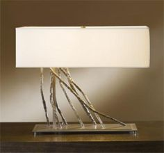 Check out this unique award winning table lamp from Hubbardton Forge's Brindille series.
