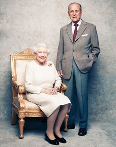 Queen Elizabeth II Prince Philip platinum wedding anniversary. If their faces weren't familiar, they could be any middle class couple having a portrait made at a photographer's studio.