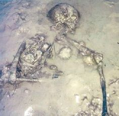 Remains found on Isle of Wight beach belong to Iron Age woman, 2000 years ago. It was first thought to be a recent homicide!