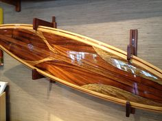Stunning curly Koa surfboard at www.martinandmacarthur.com