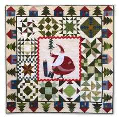 Imagine+the+happiness+of+Santa!++Here's+his+little+village+and+he's+smack+dab+in+the+center+of+it+all.++This+is+a+fun+quilt+to+make+-+simple+applique+for+the+center+block+with+12+delightful+blocks+surrounding+the+center,+and+the+outer+border+are+the+little+houses+and+trees+in+his+special+village…