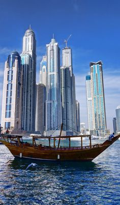 Dubai Marina with skyscrapers and boats in Dubai, United Arab Emirates! #Evolutiontravel #Dubai