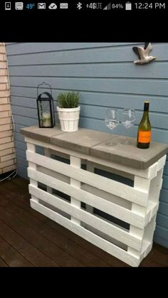 Outdoor shelf: paint 2 palettes white and set 3 concrete slabs on top. Also want to add herbs on the side of the palette