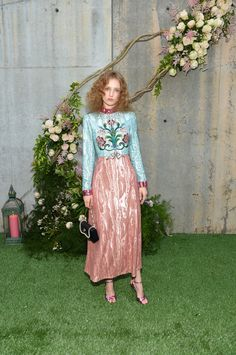Campaign star Petra Collins wore a Gucci Pre-Fall 2017 tulle embroidered dress, sandals and evening bag.