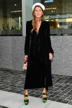 Anna dello Russo Little Black Dress - Anna dello Russo kept it classic in a black Prada velvet dress with a lace-up neckline during the label's private dinner.