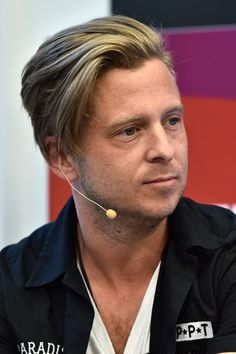 "Ryan Tedder Photos Photos - Singer- songwriter Ryan Tedder of OneRepublic speaks onstage during the VR IS ""KIDS"" PLAY Lunch, Exclusive Screening"